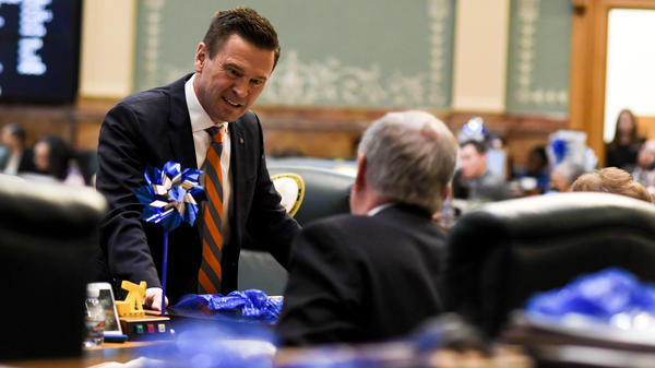 Colorado State Rep. Cole Wist speaks to State Rep. Larry Liston at the Colorado State Capitol on April 25, 2018. Wist, a Republican, is one of the sponsors of a bill that would allow guns to be temporarily taken away from someone who is a significant risk to themselves or to others.