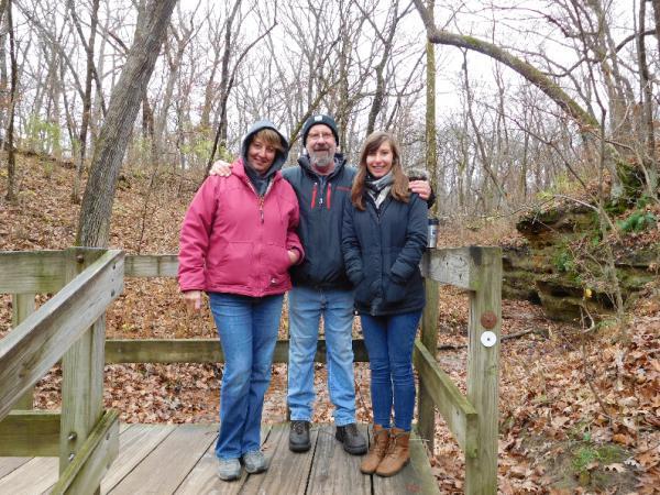 Larry Lenkart (center) with his wife Karen (left) and daughter Maggie in 2016.