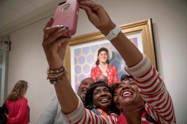 Relatives of Henrietta Lacks were on hand when her portrait went on display at the Smithsonian's National Portrait Gallery in Washington, D.C. Granddaughters Jeri Lacks-Whye (right) and Kimberly Lacks (center) pose with other direct descendants for a selfie in front of the portrait.