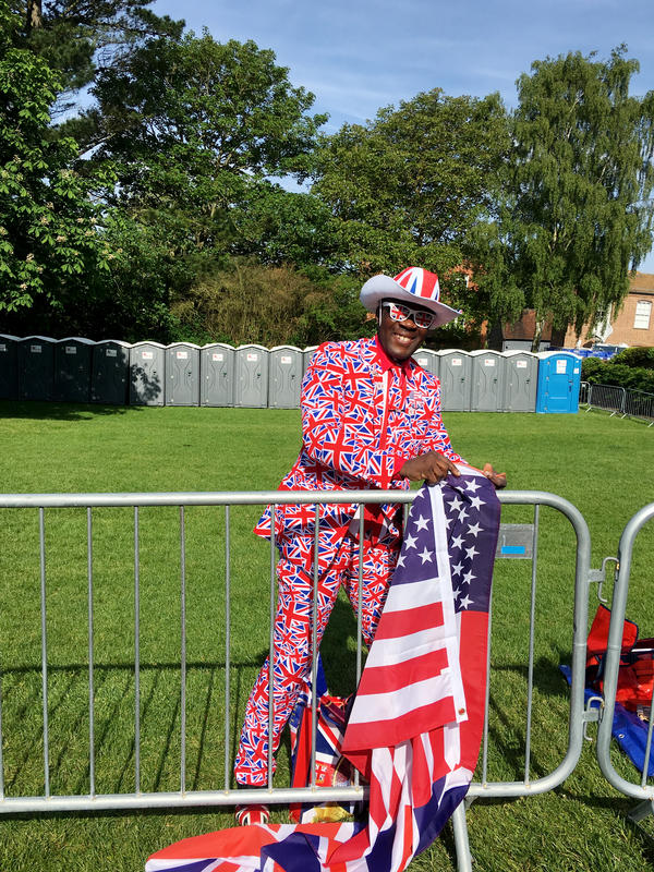 """Joseph Afrane, originally from Ghana, is a royal """"super-fan"""" and stakes out a spot on the Long Walk that leads up to Windsor Castle."""