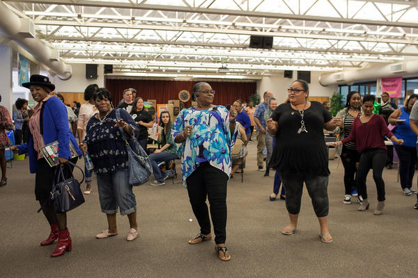 "Students, teachers and community members break into the ""Electric Slide"" during the Spring Fair."