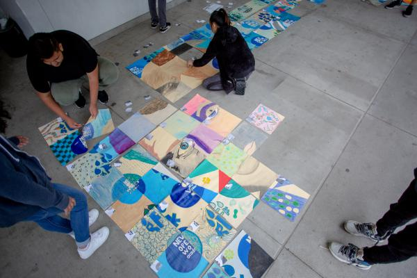 Art students work on a collaborative mural at the Robert F. Kennedy Community Schools in Los Angeles.