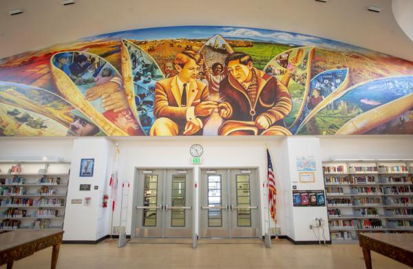Many murals line the walls at the Robert F. Kennedy Community Schools, like this one in the library.