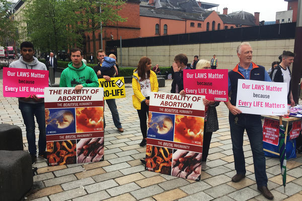 Anti-abortion groups stage a counterprotest in Belfast. Some of them are members of the group Precious Life.