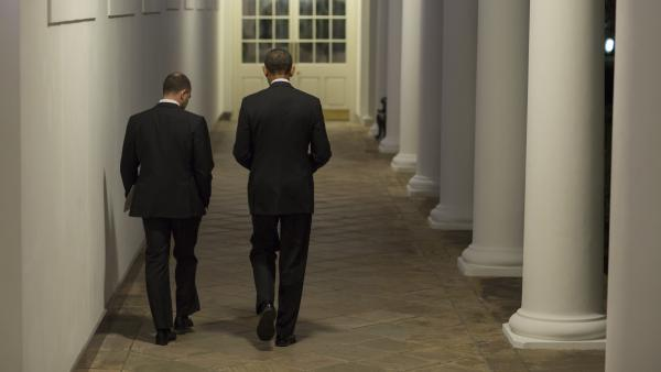 Former Deputy National Security Adviser Ben Rhodes, shown here walking with President Barack Obama, says Obama was bothered by the perception that he was aloof.