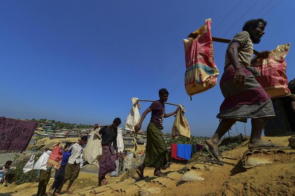 Rohingya Muslim refugees carry brick to make road at Kutupalong refugee camp in Bangladesh's Ukhia district on Jan. 23.