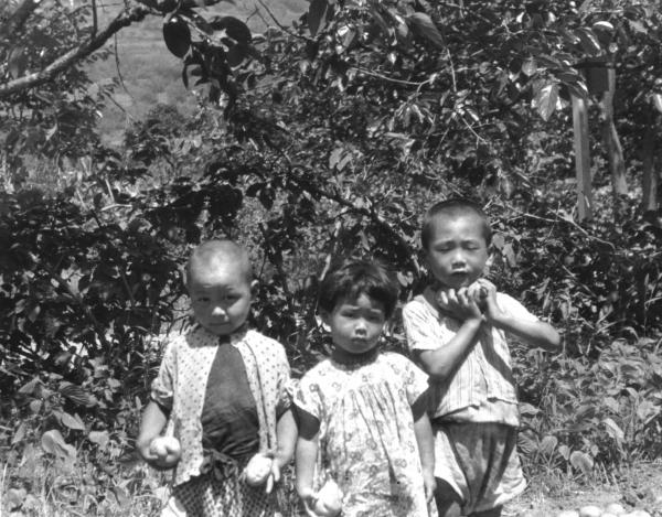 In Aizu, Japan, Hirono is pictured in the middle with her brother Roy to the right.