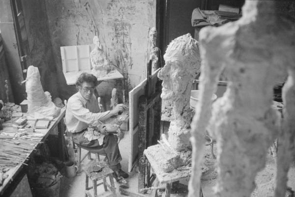 Giacometti paints in his Paris studio in 1958.