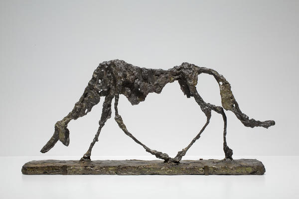 Alberto Giacometti didn't sculpt heroes on horseback; he depicted everyday humans — and animals — struggling to get through the day. Above, his 1951 bronze sculpture <em>Dog </em>(<em>Le chien</em>).
