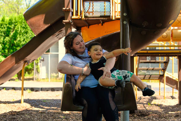 "Mother and son take a play break near their home in Douglassville, Pa. ""I'm really lucky, Kelly Zimmerman says, because my family has made a lot of adjustments — a lot of changes to help me get back on my feet."""