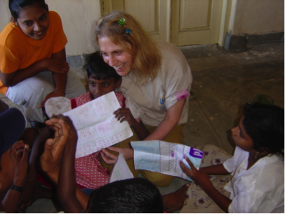 Dr. Judith Kuriansky with children drawing pictures post-tsunami in Sri Lanka. (Courtesy Judith Kuriansky)