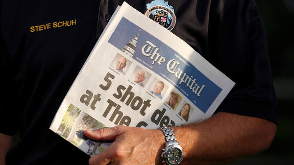 Steve Schuh, county executive of Anne Arundel County, Md., holds a copy of Friday's <em>The Capital</em>.