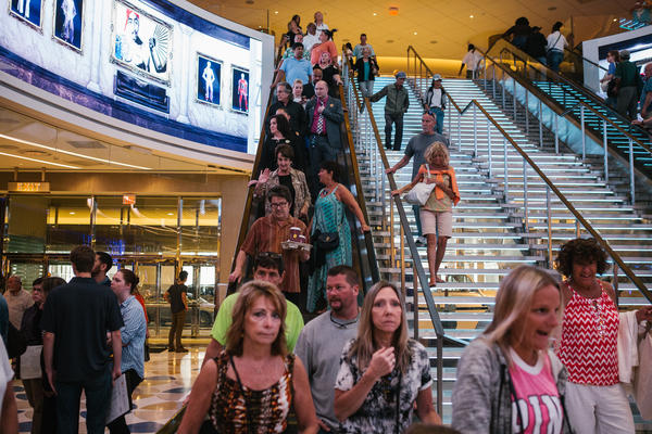 Patrons come down the escalator for the opening day of the Hard Rock Hotel and Casino in Atlantic City, N.J. on Thursday.