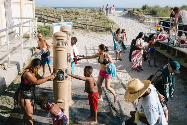 Beachgoers shower off on the boardwalk in Atlantic City, N.J. on Thursday.