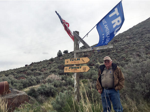 Rancher Buck Taylor proudly flies his American and Trump flags off his driveway mailboxes and signpost in Diamond Valley, Oregon.