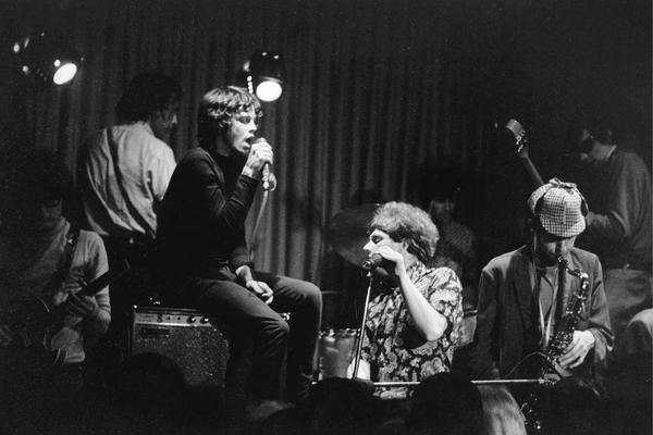 Jim Morrison, seated on an amplifier, sits in with the band Them at the Whisky a Go Go in 1966. Van Morrison (no relation) is at the keyboard.