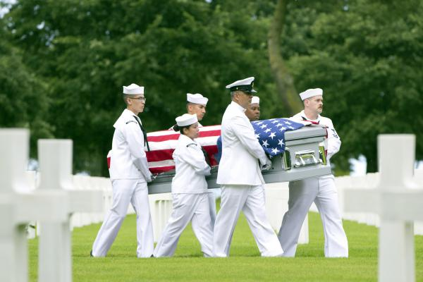 """U.S. Navy personnel carry the casket of World War II sailor Julius """"Henry"""" Pieper during a reburial service at the Normandy American Cemetery, Colleville-sur-Mer, France, on June 19. Seventy-four years to the day after their ship hit a mine off the coast of Normandy and sank, the soldier's remains were finally reunited with, and laid to rest beside, his twin brother Ludwig """"Louie"""" Pieper."""