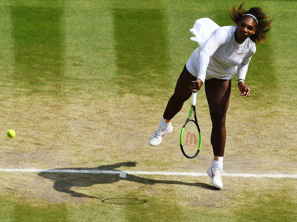 Serena Williams of The United States serves against Julia Goerges of Germany during their Ladies' Singles semi-final match on day 10 of Wimbledon on July 12, 2018 in London.