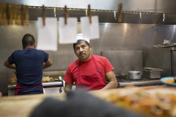 Armando Hernandez prepares lunch orders at El Torito restaurant in Galax, Va. El Torito is one of several Mexican restaurants in town and the servers say that their clientele is predominantly white local residents.
