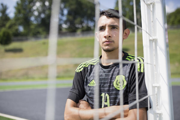 Ricardo Osuna, who graduated from Galax High School this spring, stands in the goal at the high school field.