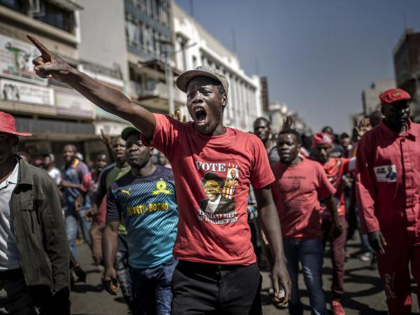 Supporters of the Movement for Democratic Change, Zimbabwe's primary opposition party, protest against alleged fraud by the election authority and ruling party Wednesday in Harare.