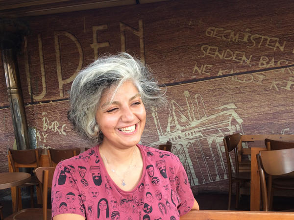 Atefeh Ahmadi, a 29-year-old freelance translator from Tehran, lets her hair show in Turkey. She fled Iran after staging protests for Iranian women's rights.