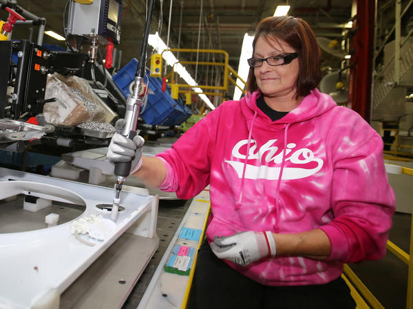 "Deb Eisenhawer assembles a switch for a washing machine at a Whirlpool plant in Clyde, Ohio. The company's CEO says steel costs have reached ""unexplainable levels."""