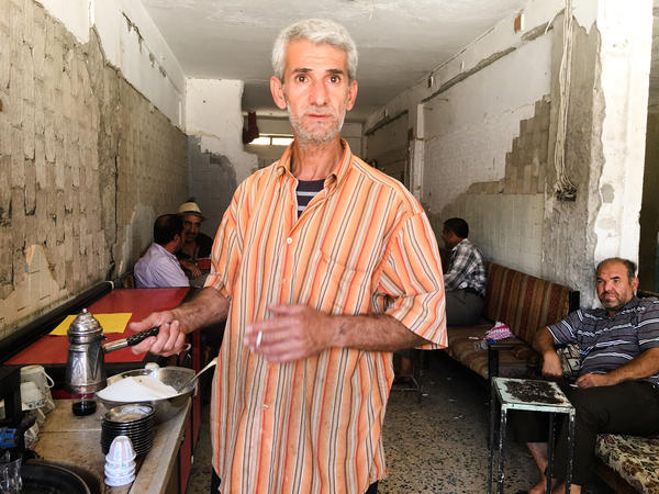 Radhwan Shukri owns the first tea shop to reopen in Mosul's Old City. Shukri closed his shop after he was repeatedly arrested and whipped by ISIS for letting his customers smoke. He reopened the shop a few months after the city was taken back from ISIS last year.