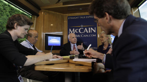 """McCain meets with reporters on his campaign bus, """"Straight Talk Express,"""" in 2008. McCain may have been one of the last presidential candidates to give reporters regular, unfettered access."""