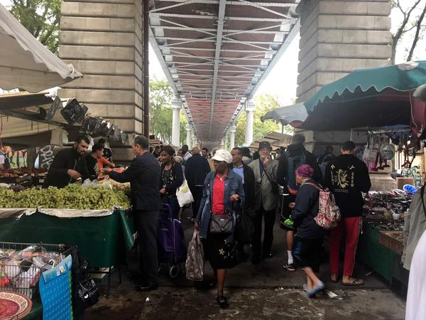 The market near the Barbes-Rochechouart Metro stop is bustling on an August day.