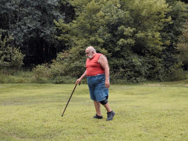 Despite his disabilities, Nicolaou and his wife live a good life on a pretty piece of land in a wooded area. He feels rooted here, and content with his choices.