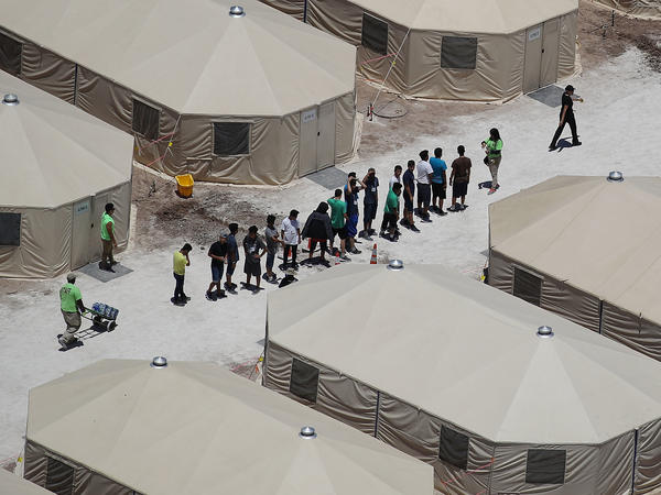 Children and workers are seen at a tent encampment built near the Tornillo Port of Entry in June in Tornillo, Texas.