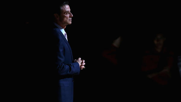 Rick Pitino receives a pre-game introduction at a Louisville Cardinals basketball home game in late 2015. The former coach has written a new memoir addressing the scandals that plagued his tenure at Louisville.