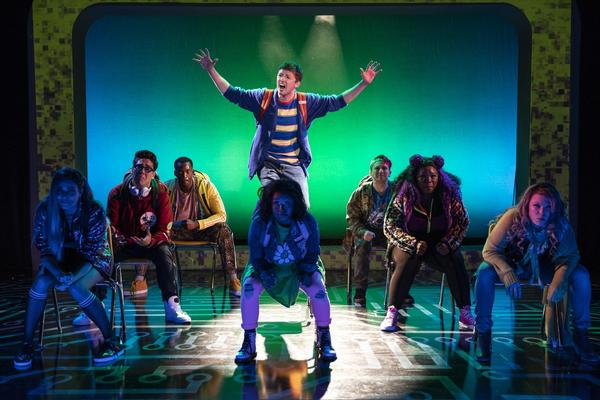 In the current production of <em>Be More Chill</em>, an unpopular high school student named Jeremy (played by Will Roland, center) swallows a pill (which is actually a microcomputer) in order to be more, well, chill. The show moves to Broadway in early 2019.