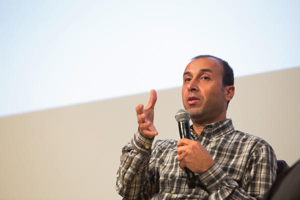 "Mohammad Alahmad, a Syrian academic, speaks at a New University in Exile Consortium event last week. Alahmad continued teaching at Raqqa University until ISIS shut down the school. ""I decided to stay to help students,"" he said, ""to continue teaching as much as we can."" He and his family left Syria after the university was shut down."