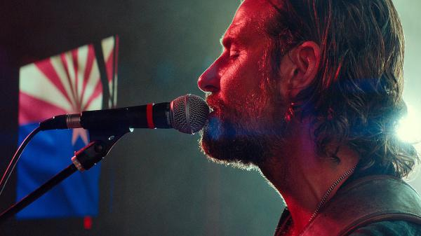Bradley Cooper plays musician Jackson Maine in <em>A Star Is Born</em>. In addition to playing the male protagonist, Cooper is making his directorial debut.