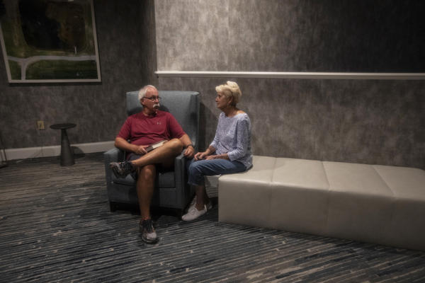 """George and Zelda Allen find a quiet corner in the Hotel Ballast. The Allens live in Hampstead, northeast of Wilmington, and checked in on Wednesday to seek refuge from the storm. They stayed home during Hurricane Hugo and felt it was too """"nerve-wracking"""" to do it again."""
