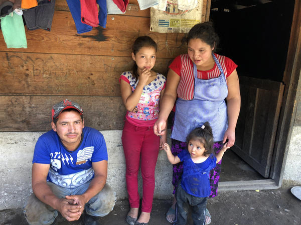 "Secundino Funes with his wife and two of their five children. Last year, he borrowed 85,000 <em>quetzales</em>, about $11,000 to make the trip north but the U.S. Border Patrol caught him. ""I owe 85,000 quetzales. I have to pay it back. I can't earn it here,"" Funes says. ""So I have to go back to the other side again to earn some money to pay my debt."""