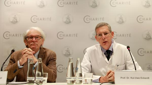 The CEO of Berlin's Charite Hospital, Karl Max Einhaeupl (left), and leading doctor Kai-Uwe Eckardt discuss the health of Pyotr Verzilov in Berlin on Tuesday. Verzilov, a member of Russian punk protest band Pussy Riot, was flown to Germany on Sept. 16 after a suspected poisoning.