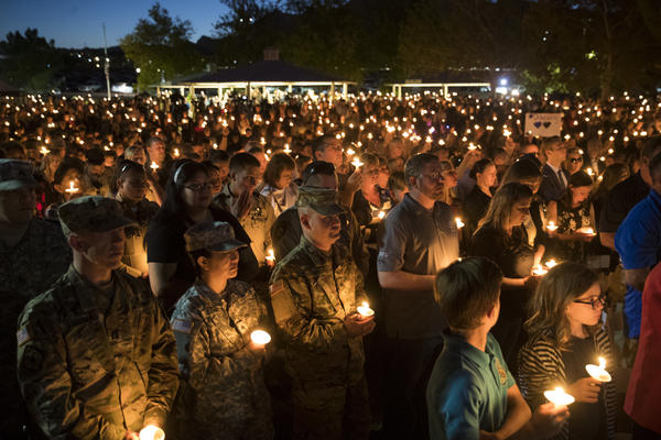 Community members hold candles as they attend a vigil for fallen Las Vegas Metropolitan Police Department Officer Charleston Hartfield. Hartfield, who was off duty, was killed when Stephen Paddock opened fire on the crowd killing at least 58 people and injuring more than 450.