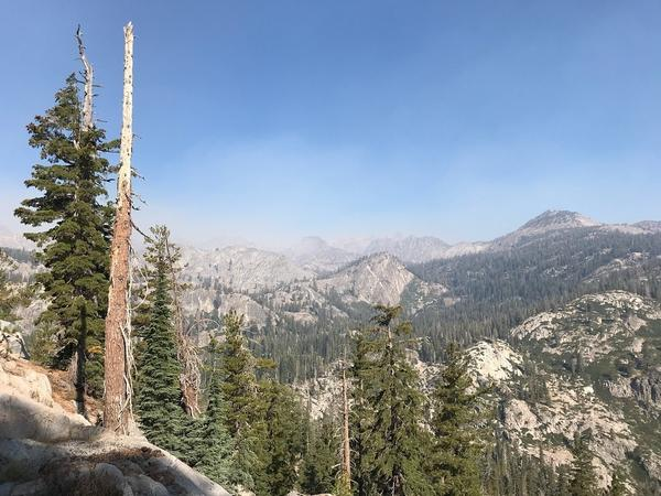 Smoke from the Lions Fire obscures granite peaks in the Sierra Nevada.