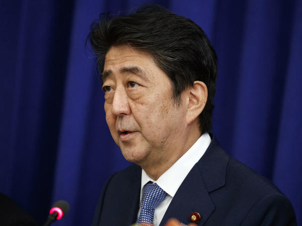 In a photo taken at last year's U.N. General Assembly in New York, Japanese Prime Minister Shinzo Abe speaks at a luncheon with President Donald Trump and South Korean President Moon Jae-in at the Palace Hotel.