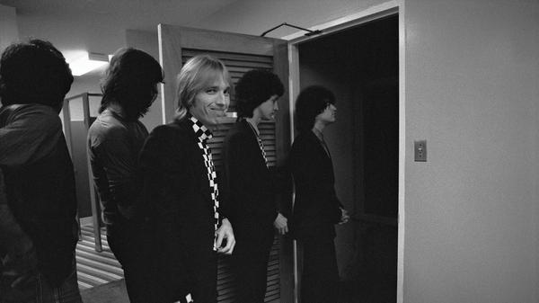 Tom Petty & The Heartbreakers about to go onstage in Honolulu, Hawaii in May 1980.