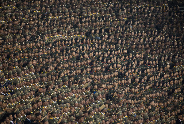 Members of the North Korean military sit in the stands of Pyongyang's May Day Stadium during a debut of a new Arirang Mass Games event to mark the 70th anniversary of the nation's founding.