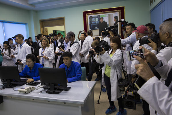 Dozens of journalists tour the operations room at a cosmetics factory in Pyongyang. More than 150 foreign journalists were invited to cover the 70th anniversary of North Korea's founding.