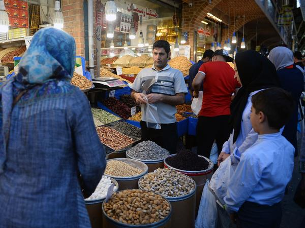 The unanimous ruling from the International Court of Justice orders the U.S. to allow Iran to import food, medical supplies and other products for humanitarian reasons. Here, people browse for goods in the Grand Bazaar in Tehran.