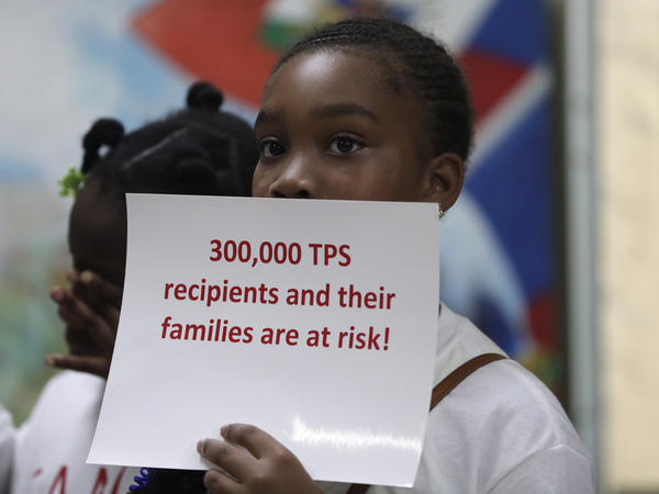 Tarauji Morris listens during a July 2018 news conference where immigration rights supporters urged the Trump administration to extend TPS.
