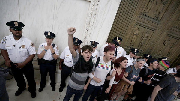 Protesters at the Supreme Court Saturday after the Senate narrowly voted to confirm Kavanaugh.