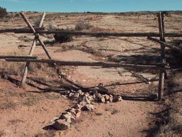 A cross made of stones, seen in 1999, at the fence where Shepard was beaten and left for dead one year earlier.