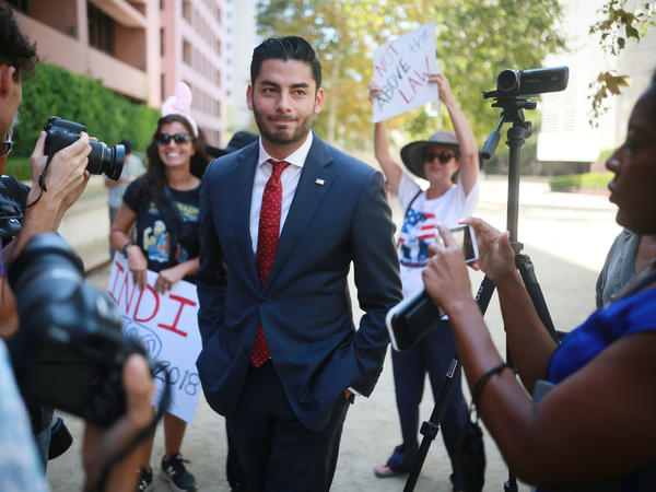 Ammar Campa-Najjar, who is running against Republican Rep. Duncan Hunter, speaks to reporters outside the San Diego Federal Courthouse during Hunter's arraignment hearing in August.